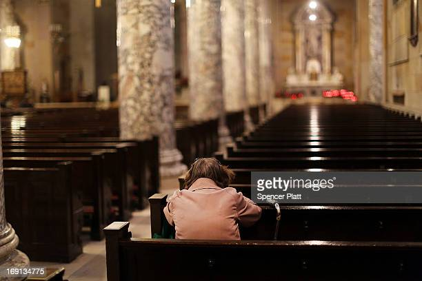 A woman prays in a Catholic church on May 20 2013 in Waterbury Connecticut Waterbury once a thriving industrial city with one of the largest brass...