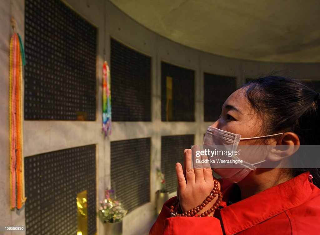 A woman prays in front of plates showing the names of the victims in the 1995 'Great Hanshin earthquake' during a memorial ceremony on January 17, 2013 in Kobe, Japan. Memorial services were held to mark the 18th anniversary of the 1995 massive earthquake, hundreds of people gathered early this morning to pay their respects and light bamboo lanterns in the park for more than 6,400 people who lost their lives in the 7.3 magnitude earthquake.