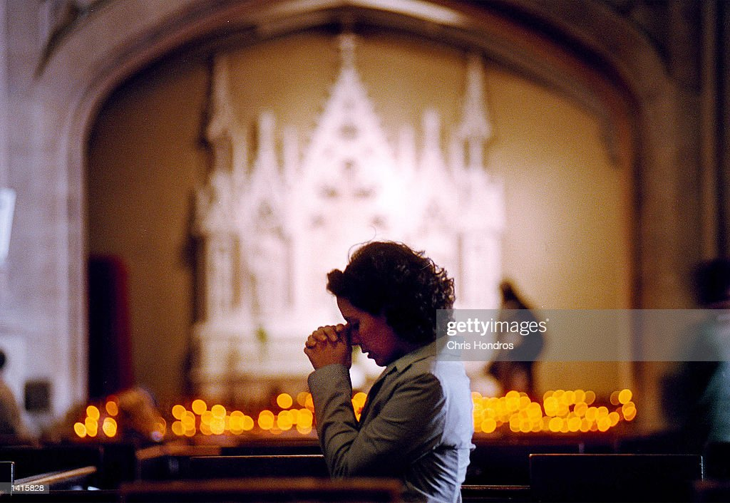 A woman prays in the pews of St Patrick''s Cathedral mourning the death of Cardinal John O''Connor May 4 2000 in New York City Hundreds of people...