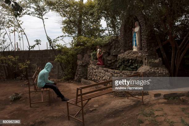 A woman prays inside the grounds of Our Lady of Guadalupe Parish in the Kibera slum on August 13 2017 in Nairobi Kenya A day prior demonstrations...