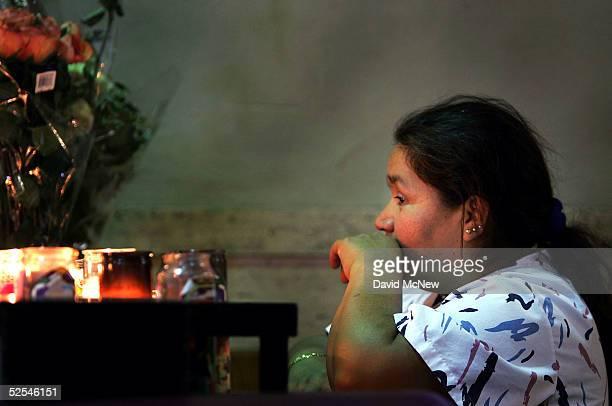 A woman prays inside the Iglesia de la Placita at Nuestra Senora Reina de Los Angeles or Our Lady Queen of Angeles Church on March 31 2005 in Los...