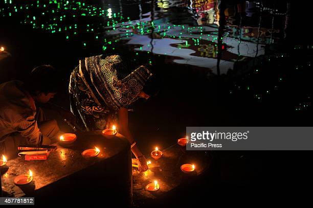 Woman prays to Goddess Kali with fire 'Kali Puja' is a festival dedicated to Hindu Goddess Kali during the new moon day in the Hindu month Maithili...
