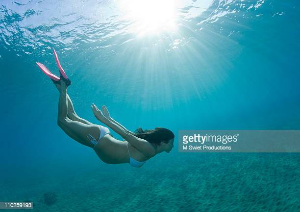 Woman pregnant free diving underwater
