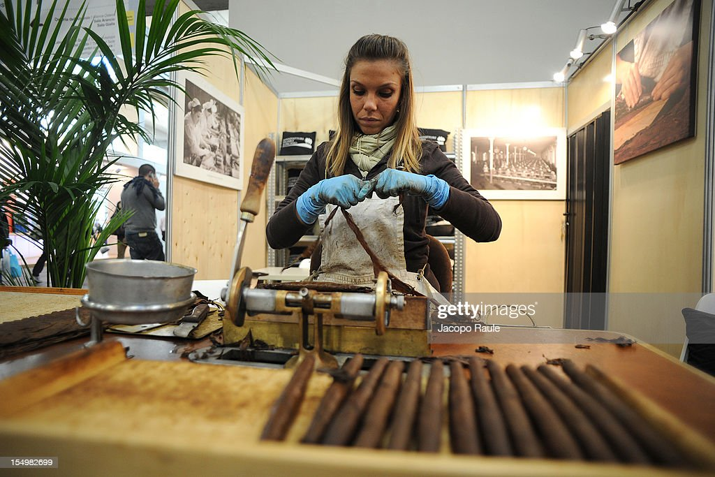 A woman prepares a Tuscany cigar during the Slow Food's Salone del Gusto and Terra Madre 2012 on October 29, 2012 in Turin, Italy.