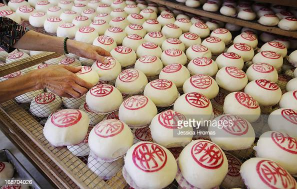 A woman prepares Cheung Chau Buns at the Cheung Chau Bun Festival on May 14 2013 in Hong Kong Hong Kong Today is the start of the Cheung Chau Bun...