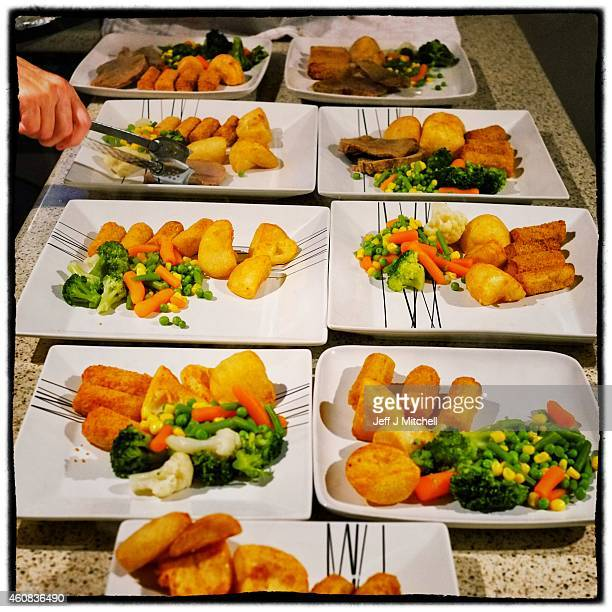 A woman prepares Christmas dinner on December 25 2014 in Glasgow Scotland Millions of people across the UK spend time with family and loved ones on...