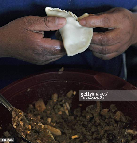 A woman prepares empanadas at a typical eating place in Salta at the foothills of the Andes mountain range in the Argentine northern province of...