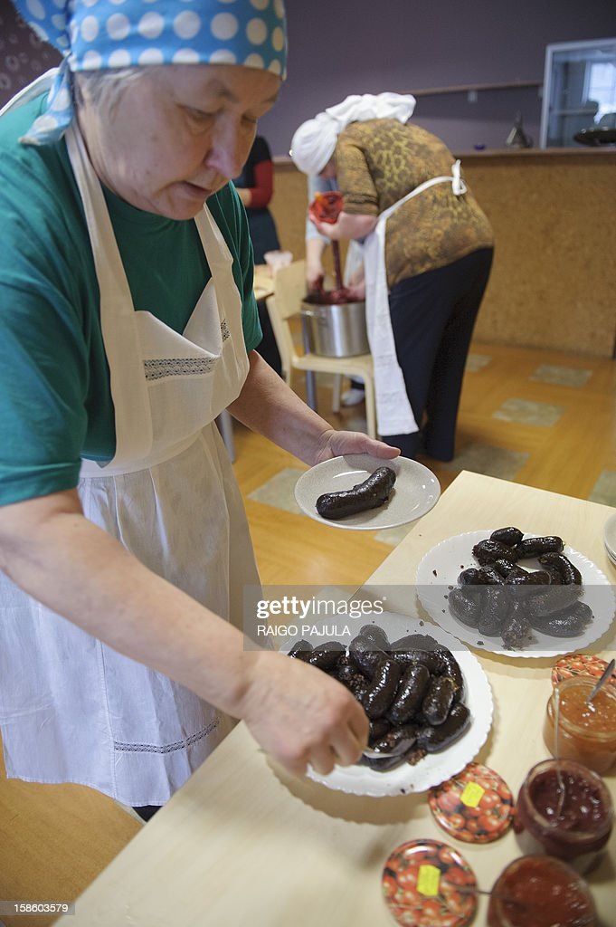 A woman prepares Estonian blood sausage in Tallinn, Estonia, on December 15, 2012.As Christmas looms, residents of the Baltic state of Estonia are bracing to wolf down tonnes of blood sausage, a staple of their holiday table. AFP PHOTO / RAIGO PAJULA