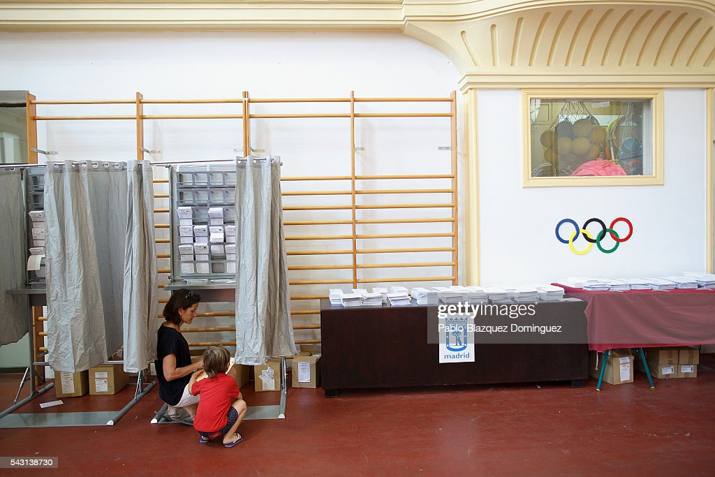 A woman prepares her ballots at a polling station during the Spanish General Elections on June 26, 2016 in Madrid, Spain. Spanish voters head back to the polls after the last election in December failed to produce a government. Latest opinion polls suggest the Unidos Podemos left-wing alliance could make enough gains to come in second behind the ruling center right Popular Party.