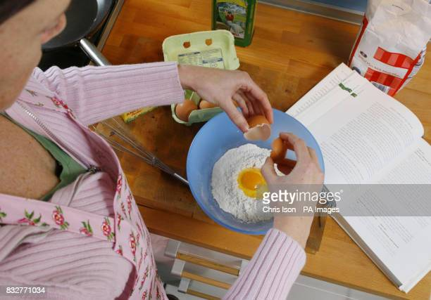 A woman prepares pancake batter in a kitchen in Southampton in preparation for Shrove Tuesday