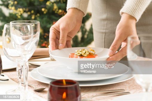 Woman preparing a diner table