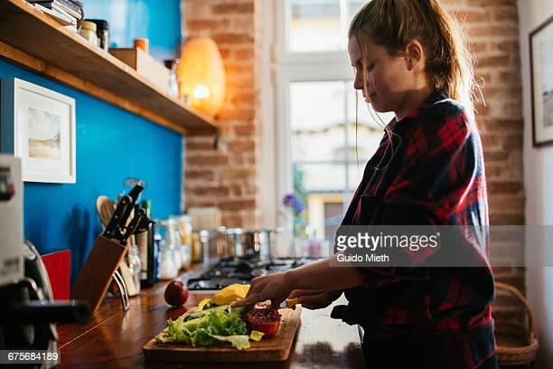 Woman preparing a smoothie.