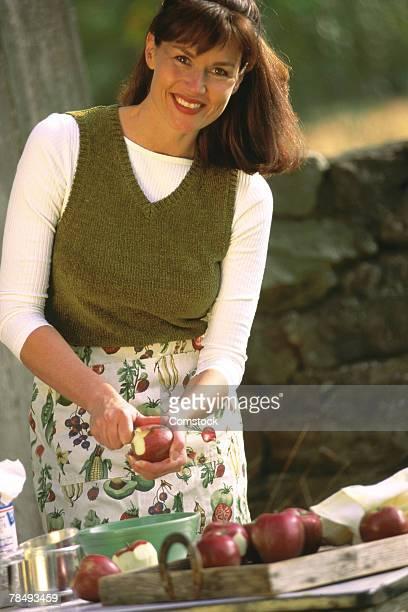 Woman preparing apples outdoors