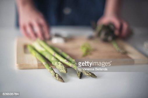 Woman preparing asparagus