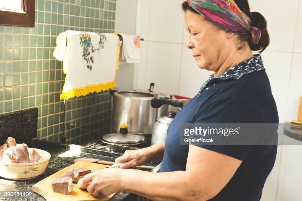 Woman preparing brazilian feijoada