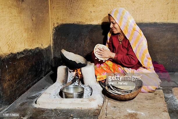 Woman preparing chapattis. India.