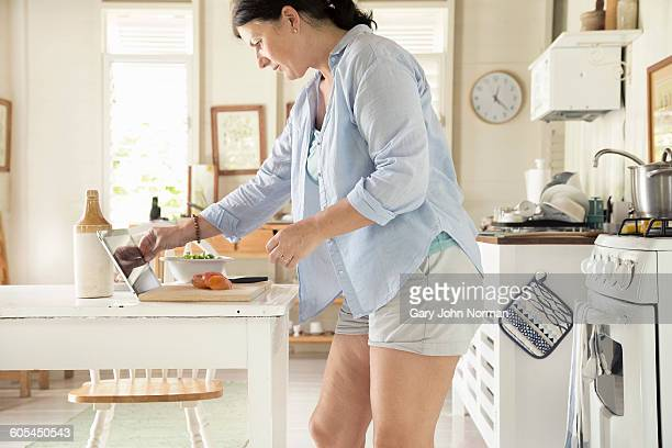 Woman preparing food in kitchen on vacation.