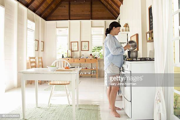 Woman preparing food in kitchen.