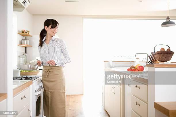 Woman preparing food in kitchen