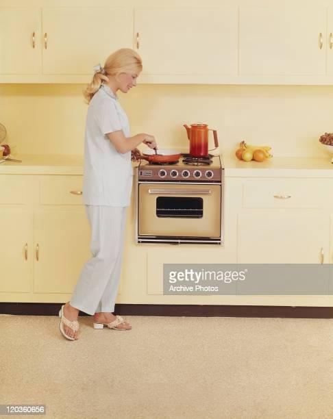 Woman preparing food, smiling