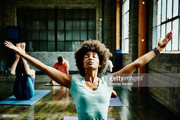 Woman preparing for class in yoga studio