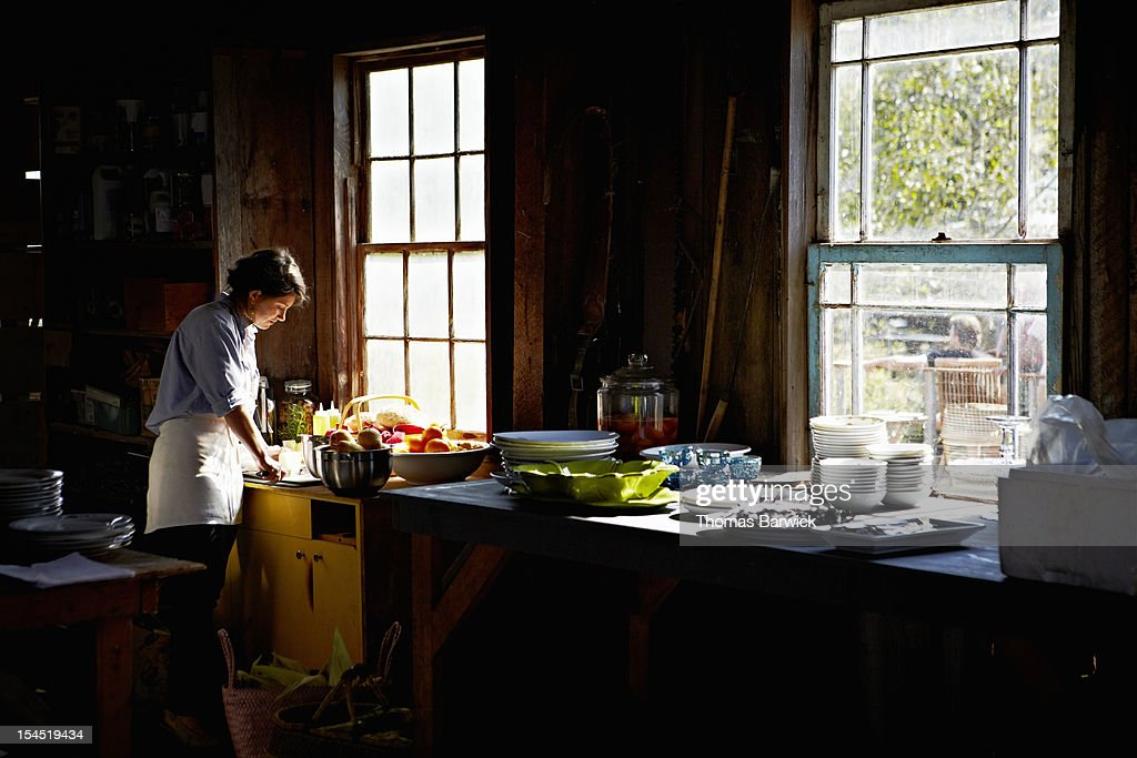 Woman preparing for party in vacation home kitchen : Stock Photo