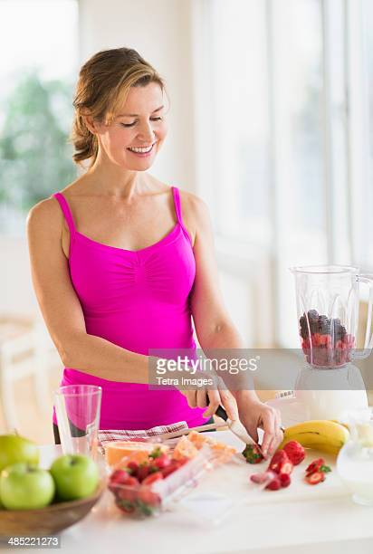 Woman preparing fruit drink