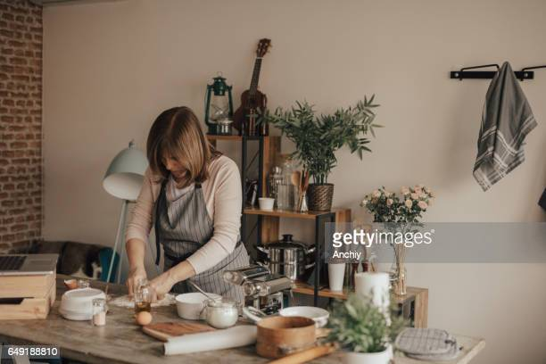 Woman preparing home made pasta