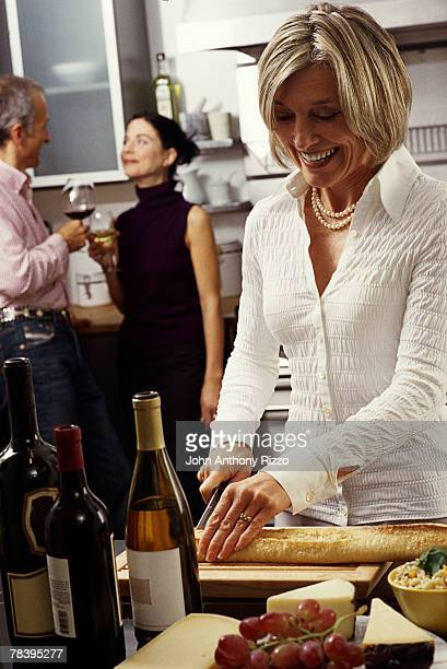 Woman preparing hors d'oeuvre at dinner party