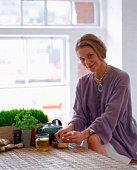 Woman preparing natural remedy
