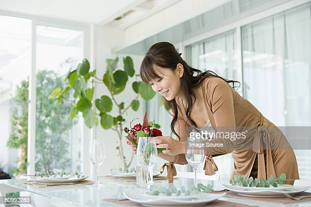 Woman preparing table