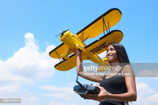 Woman preparing to launch model plane