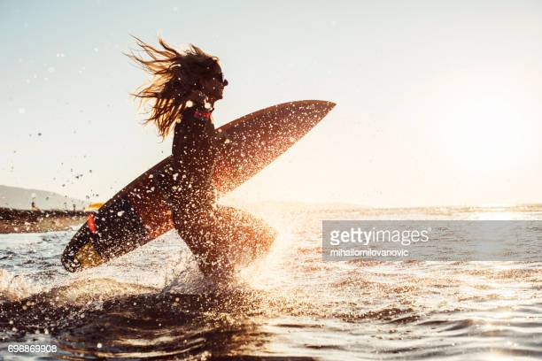 Woman preparing to surf