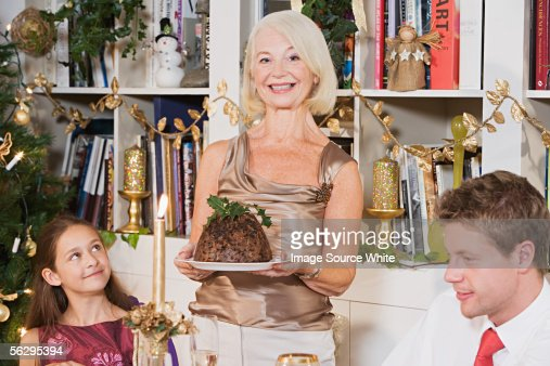 Woman presenting a Christmas pudding : Stock Photo
