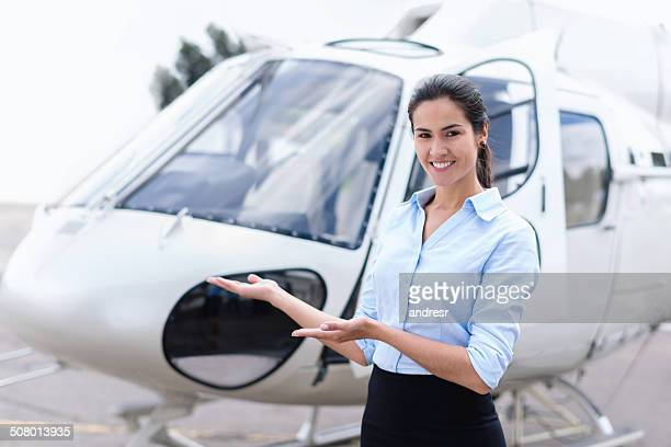 Woman presenting a helicopter