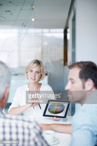 Woman presenting her results : Stock Photo