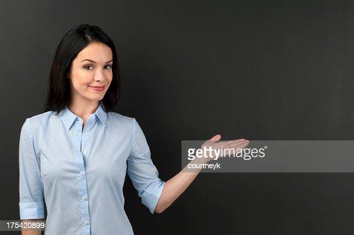 Woman presenting something on a blackboard