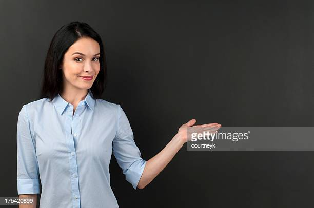 Woman presenting something on a blackboard