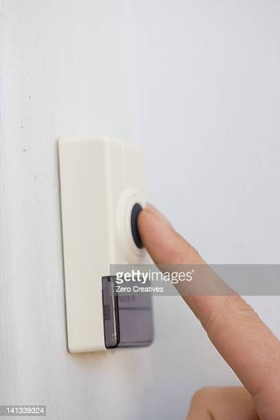 Woman pressing button