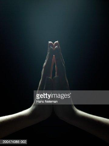 Woman pressing palms together, close-up : ストックフォト