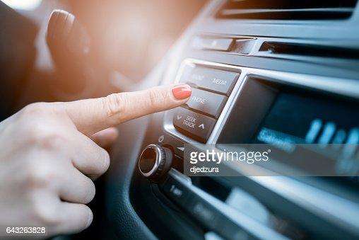 Woman pressing phone control button : Foto stock