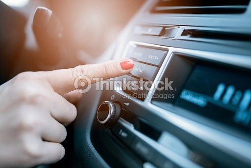 Woman pressing phone control button : Foto stock