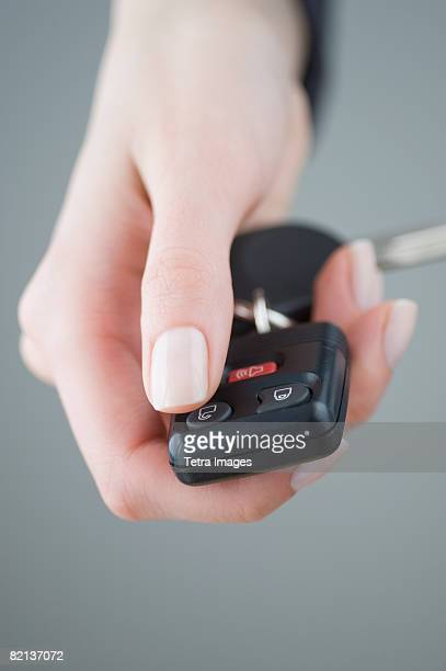 Woman pressing unlock button on keychain