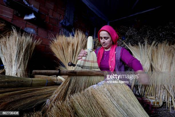 A woman produces brooms at Alibeyli village of Carsamba district in Samsun Turkey on October 18 2017 The village dwellers who learn making brooms...
