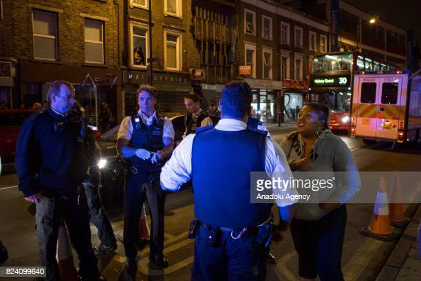 A woman protester argues with police after a demonstration demanding justice after the death of Rashan Charles who was killed last weekend after...