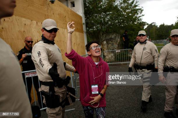 A woman protests as she is guided out by members of the Florida Highway Patrol after she was refused entry into a planned speech by Richard Spencer...