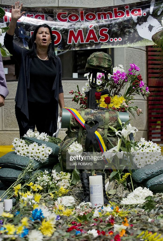 A woman protests at the entrance of the Pichincha Battallion barracks in Cali department of Valle del Cauca Colombia on April 16 for the killing of...