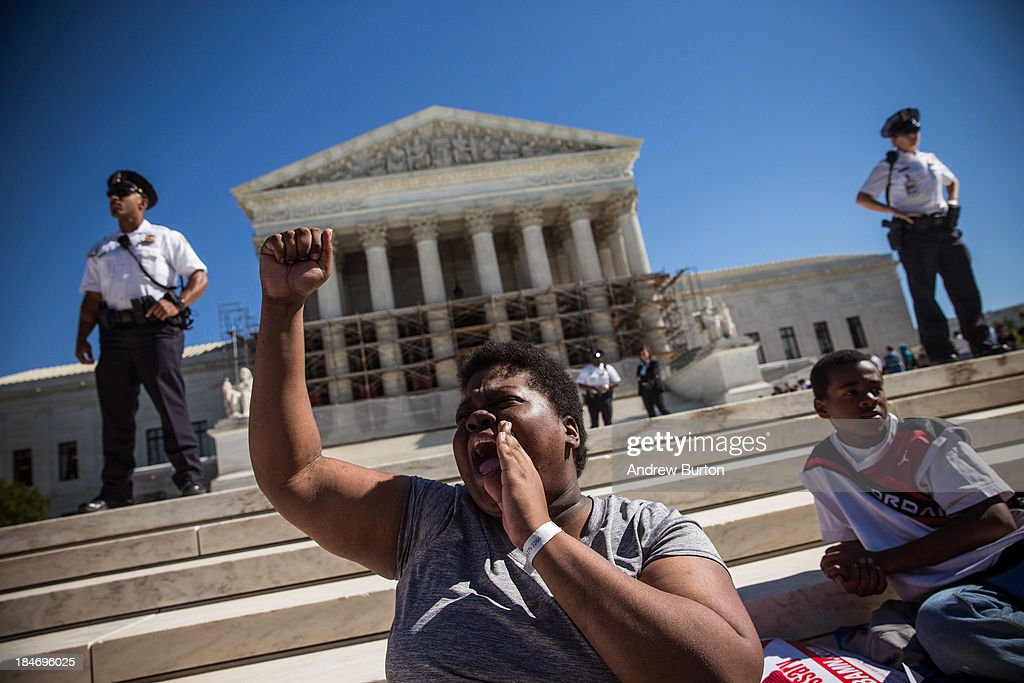 A woman protests in support of affirmative action, outside the Supreme Court during the hearing of 'Schuette v. Coalition to Defend Affirmative Action' on October 15, 2013 in Washington, DC. The case revolves around affirmative action and whether or not states have the right to ban schools from using race as a consideration in school admissions.