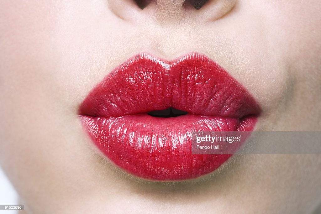 Woman puckering lips, close-up : Stock Photo