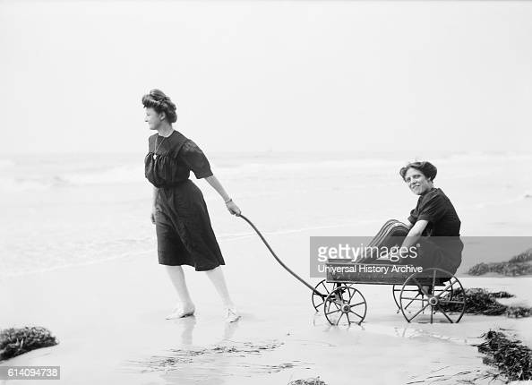 Woman Pulling another Woman in Wagon on Beach USA circa 1905